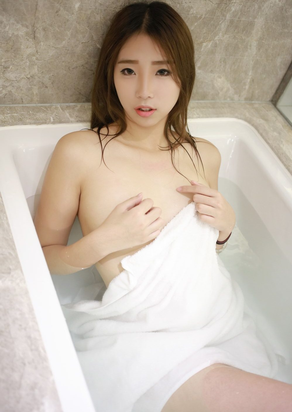 petite girl gets naked and naughty on the bathroom